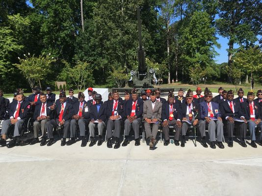 The surviving Montford Point Marines gather in front of a new monument unveiled for them at Camp Lejeune, N.C., on Friday. Montford Point Marines were the first African American men to join a still-segregated Marine Corps during World War II.(Photo: Lance M. Bacon/Staff)